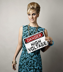 Dusty posing with High Voltage sign